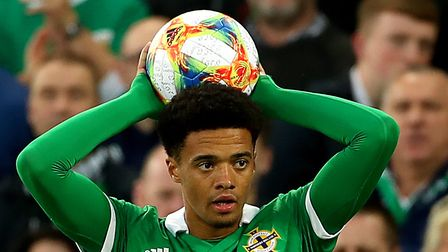 Norwich City youngster Jamal Lewis takes a throw for Northern Ireland during their big European Cham