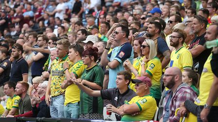 The traveling Norwich fans during the Premier League match at the London Stadium, StratfordPicture b