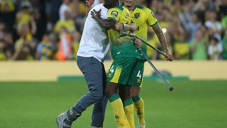 Injured Norwich City defender Christoph Zimmermann congratulates Ibrahim Amadou after a superb 3-2 P