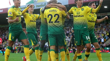 Sam Byram, second from left, celebrates after Teemu Pukki's goal against Manchester City Picture: Pa