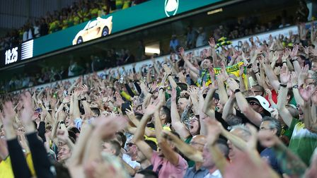 """The Barclay stand does the """"Farke arms"""" as Norwich Head Coach Daniel Farke does his trademark celebr"""