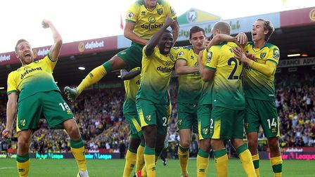 Jubilation for the Norwich City players after Teemu Pukki scored a third goal during their unexpecte