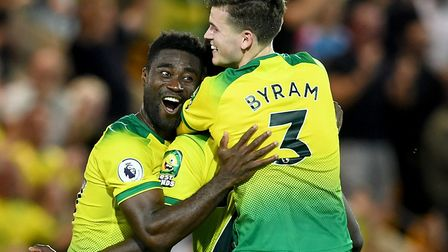 Alex Tettey, left, and Sam Byram celebrate Norwich City's victory over Manchester City with Ibrahim