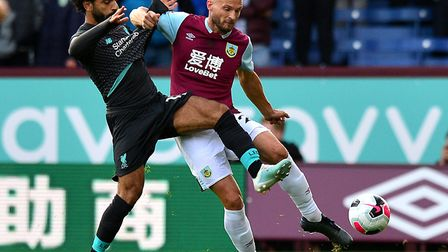 Burnley defender Erik Pieters, right, contends with Liverpool star Mo Salah earlier this season Pict