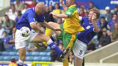 Iwan Roberts comes up against Sean Dyche, then playing for Millwall, in August 2001 Picture: Archant