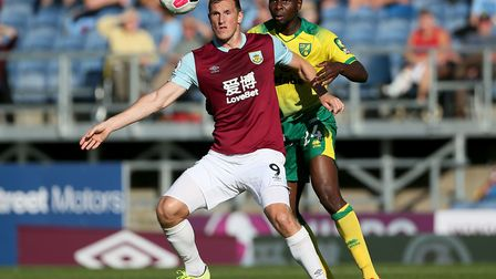 Norwich City defender Ibrahim Amadou keeps a tight leash on Burnley's two-goal hero Chris Wood at Tu