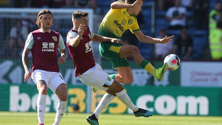 Todd Cantwell attempts to escape unwanted attention from Matthew Lowton during Norwich's 2-0 at Turf