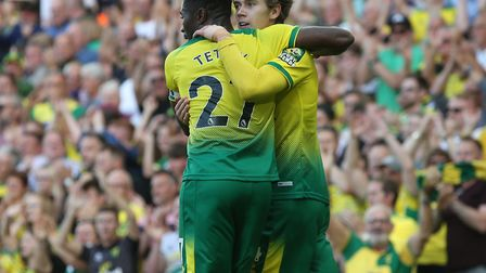 Todd Cantwell is congratuled on his goal against Manchester City by Alex Tettey Picture: Paul Cheste