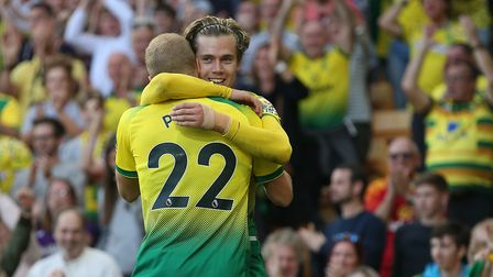 Todd Cantwell celebrates scoring Norwich City's second goal against Manchester City at Carrow Road.