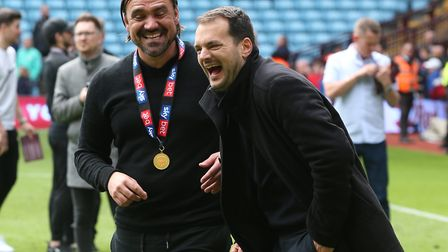It was all smiles for Stuart Webber, left, and Daniel Farke after City wrapped up their Championship