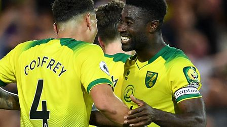 Alex Tettey celebrates Norwich City's shock victory over Manchester City with Ben Godfrey Picture: J
