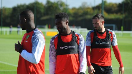 Irahim Amadou, Alex Tettey and Josip Drmic of Norwich City train ahead of Burnley 19/09/2019