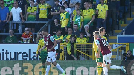 The traveling Norwich fans look dejected as Chris Wood of Burnley celebrates scoring his sideÕs 2nd