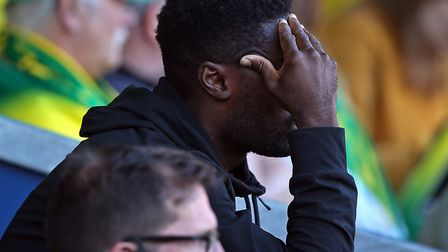 Alex Tettey cut a dejected figure after his early injury exit in Norwich City's 2-0 Premier League d