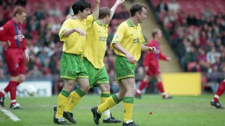 City trio Rob Ullathorne, Jamie Cureton and Mike Milligan celebrate after an own goal by David Hopki