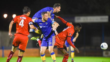 Ryan Jarvis in the thick of the action for King's Lynn Town in their midweek FA Cup replay win over