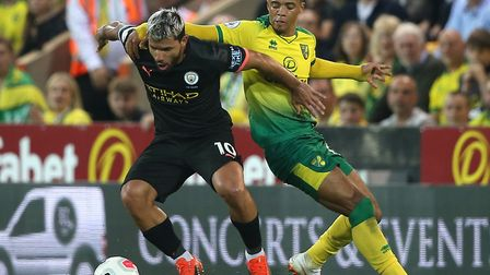 Left-back Jamal Lewis keeps tabs on Manchester City star Sergio Aguero at Carrow Road Picture: Paul