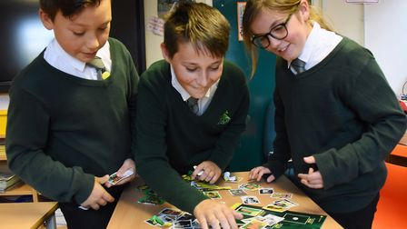 Children at Firside Junior School enjoying opening the NCFC stickers to collect by the Eastern Daily