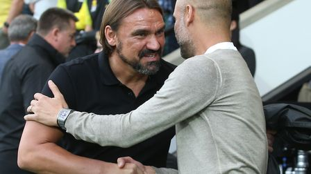 Nice to beat you ... Daniel Farke and Manchester City manager Pep Guardiola Picture: Paul Chesterto