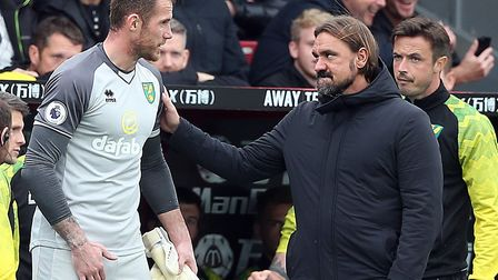 Head coach Daniel Farke consoles injured keeper Ralf Fahrmann at Selhurst Park Picture: Paul Chester