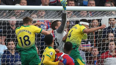 Michael McGovern punches clear under pressure during City's defeat at Crystal Palace. Picture: Paul