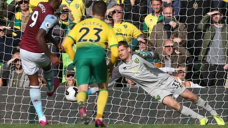 Michael McGovern denies Wesley from the penalty spot in Norwich City's Premier League defeat to Asto