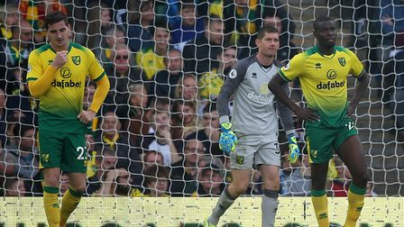 Norwich players, from left, Kenny McLean, Michael McGovern and Ibrahim Amadou look dejected after co