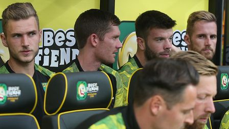 Michael McGovern and Grant Hanley chatting on the bench - McGovern will face Aston Villa, but will H