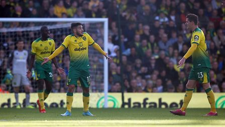 The Norwich players look dejected after conceding their side's 4th goal during the Premier League ma