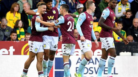 Aston Villa's Jack Grealish, left,celebrates after scoring his side's third goal at Carrow Road Pict