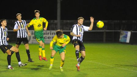 Action from last night's friendly match between Dereham Town and Norwich City Under-18s at Aldiss Pa