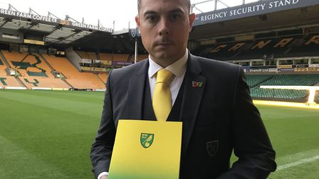 Norwich City's Chief Operating Officer, Ben Kensell with the clubs latest accounts. Picture: Neil Di