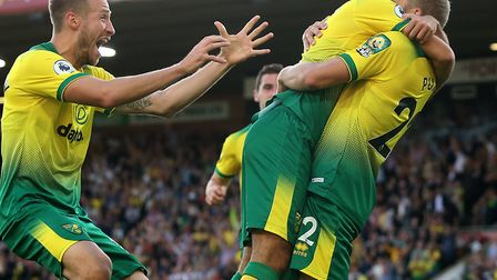 Teemu Pukki of Norwich celebrates scoring his side's third goal during the Premier League match at C