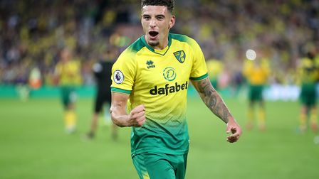 Ben Godfrey of Norwich celebrates victory at the end of the Premier League match at Carrow Road, Nor