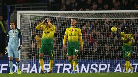 Norwich City players look dejected after conceding their second goal against Brighton. Picture: Paul