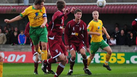 Grant Holt heads home for City in their 7-0 win at Paulton Rovers in 2009. Picture: Alex Broadway/Fo