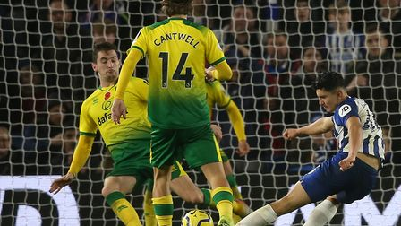Kenny McLean, left, blocks a Steven Alzate shot during Norwich City's 2-0 loss at Brighton Picture: