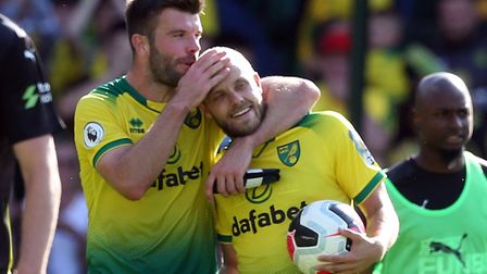 Teemu Pukki gets a hug from Grant Hanley after his hat-trick against Newcastle Picture: Paul Chester