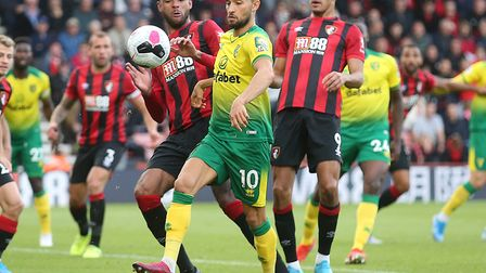 Moritz Leitner in action for Norwich City at Bournemouth, keeping a corner alive ahead of a chance f