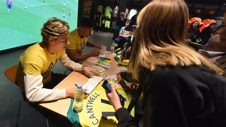 Todd Cantwell and Ben Godfrey at a signing and sticker swap at the NCFC fan hub. Picture: Jamie Hone