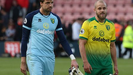 Tim Krul and Teemu Pukki, right, thanked the travelling Norwich City fans after a welcome draw at Bo