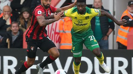 England striker Callum Wilson was one of the Bournemouth players Alex Tettey had to battle to keep q