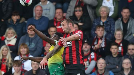 Alex Tettey and Bournemouth defender Steve Cook battle for aerial supremacy Picture: Paul Chesterton