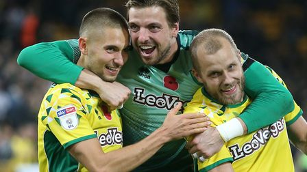 Tim Krul of Norwich, Moritz Leitner of Norwich and Teemu Pukki of Norwich celebrate victory at the e
