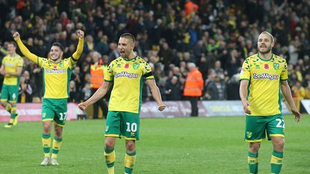 Emiliano Buendia of Norwich, Moritz Leitner of Norwich and Teemu Pukki of Norwich celebrate victory