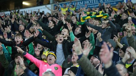 The Norwich fans celebrate victory at the end of the Sky Bet Championship match at Carrow Road, Norw