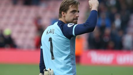 Tim Krul of Norwich celebrates his team's point with the traveling Norwich fans at the end of the Pr