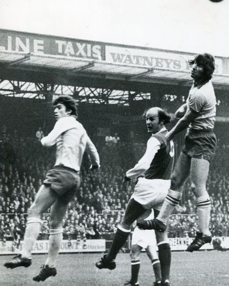 Duncan Forbes leaps above Arsenal's Terry Mancini in 1976 Picture: Archant Library
