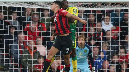 Tim Krul watches Ibrahim Amadou win an aerial battle against Bournemouth striker Dominic Solanke Pic