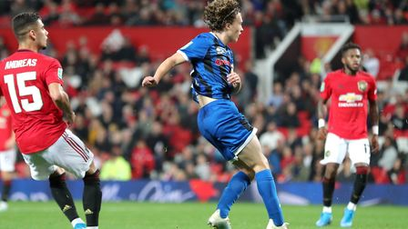 Rochdale right-back Luke Matheson watches as his volley finds the net at Old Trafford Picture: Richa